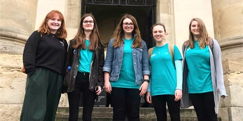 Grace, Beth, Ebie, Claire, and Holly from DisCam stand in front of the Clarendon Building. They are