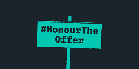 #HonourTheOffer written in dark lettering on a mint green placard