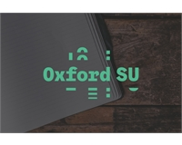 Oxford SU Logo over notepad