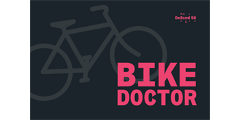 Bike graphic over black background with Bike Doctor written in pink